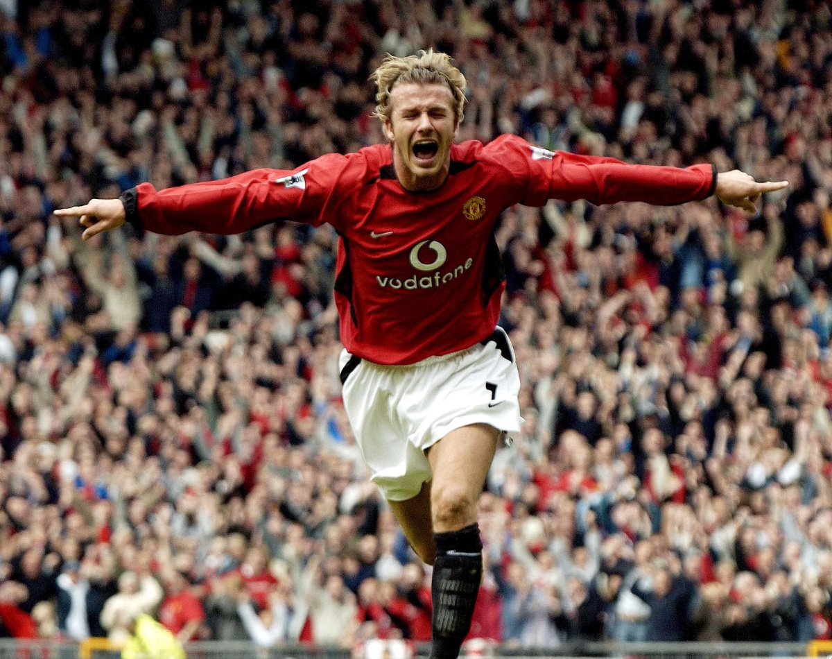 (FILES) In a file picture taken on May 3, 2003 David Beckham celebrates after making it Manchester United 1-Charlton 0 during their English Premier League football match at Old Trafford, in Manchester. David Beckham is to retire from professional football at the end of the season, his representative announced on on May 16, 2013. The 38-year-old midfielder has played for Manchester United, Real Madrid and AC Milan, as well as winning 115 caps for England, and recently won the French Ligue 1 championship with Paris Saint-Germain. AFP PHOTO / PAUL BARKERPAUL BARKER/AFP/Getty Images