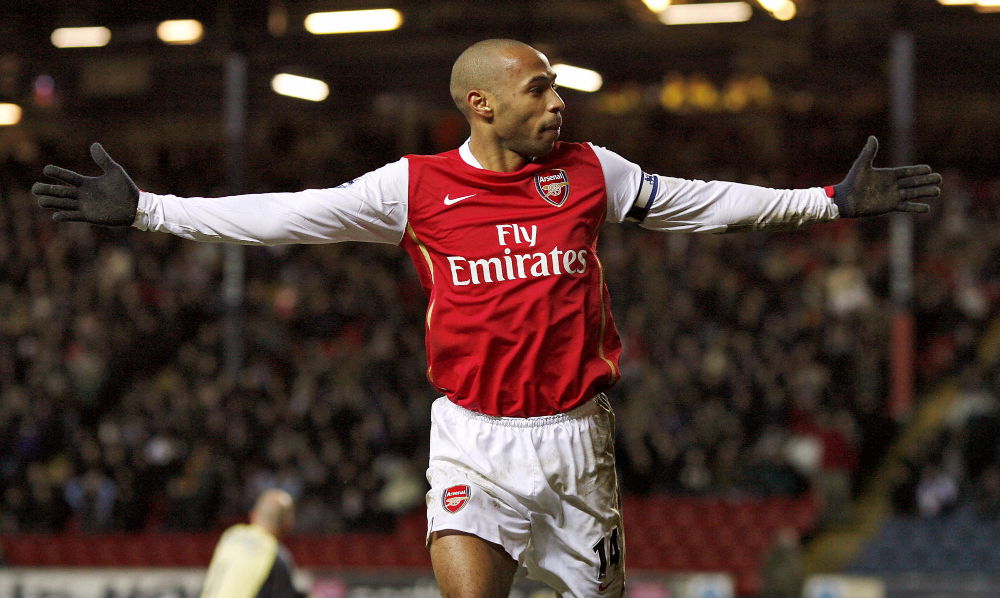 Blackburn, UNITED KINGDOM: Arsenal's Thierry Henry celebrates after scoring during their English Premiership football match against Blackburn Rovers 13 January 2007 at Ewood Park, Blackburn, North-west England. AFP PHOTO/ANDREW YATES Mobile and website use of domestic English football pictures subject to subscription of a license with Football Association Premier League (FAPL) tel : +44 207 298 1656. For newspapers where the football content of the printed and electronic versions are identical, no licence is necessary. (Photo credit should read ANDREW YATES/AFP/Getty Images)