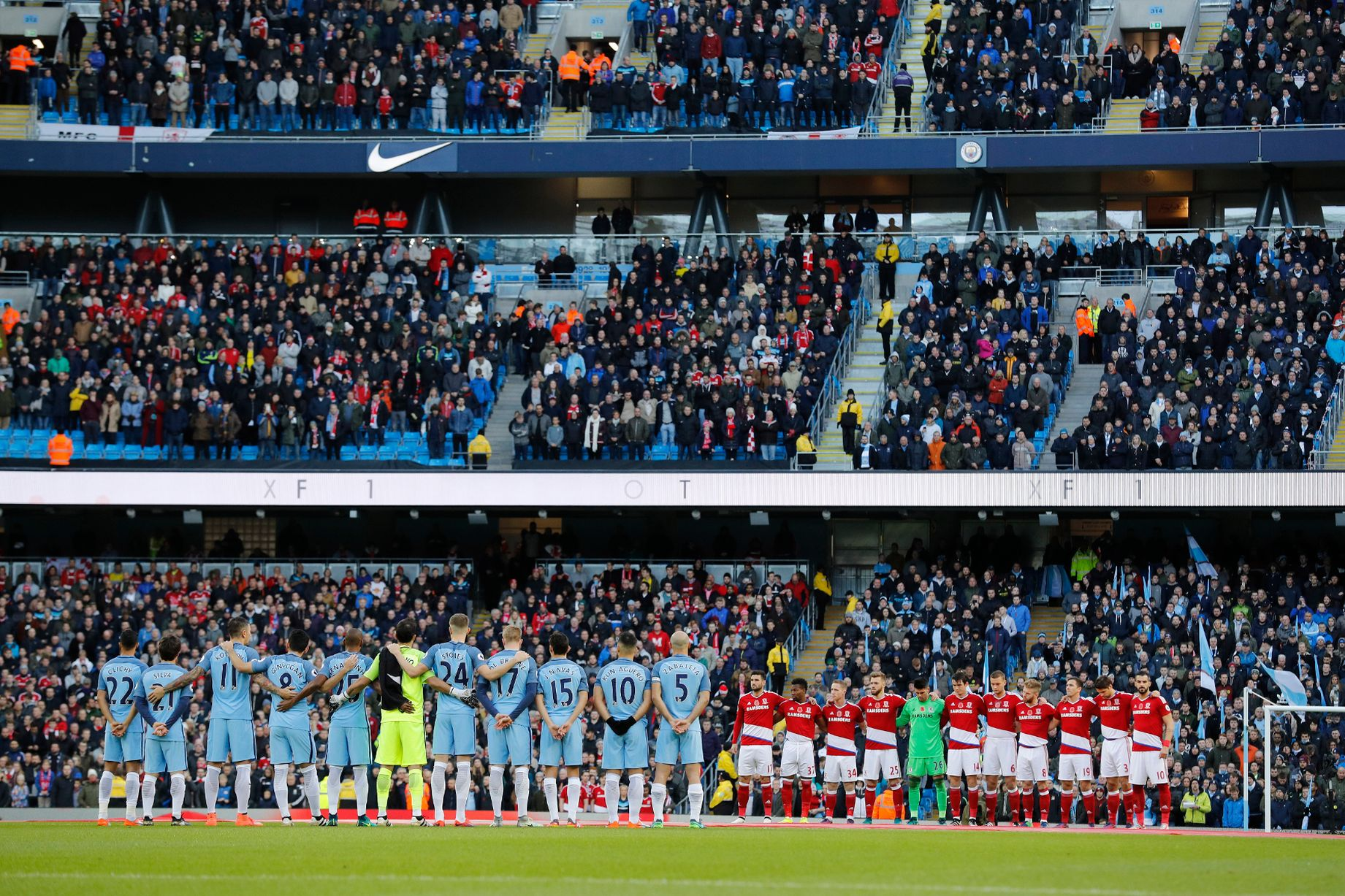 players-line-up-during-a-minutes-silence-as-part-of-remembrance-commemorations-before-the-match